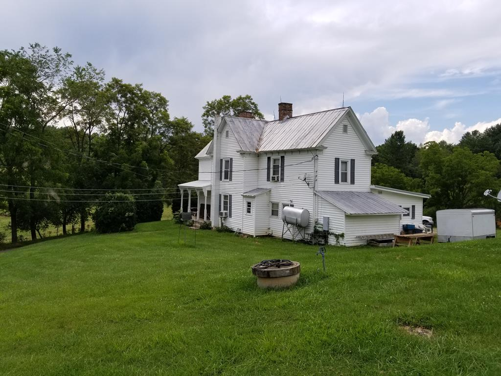 95 acres and a 1903 farmhouse located near the Little River and the New River with lots of road frontage.  Open and wooded land make up this tract with several options for building sites and lots of great hunting.   Fenced for horses and barns on property for a mini farm.     Rolling land with trails cut throughout the property.