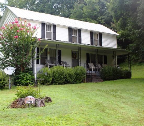 Country home with 28.25 acres located in Patrick County, Virginia (1941 Lone Ivy Road, Stuart, VA 24171). Outside of the home is (36' x 28').  Main Story:  Kitchen, Dining Room, Living Room and Bath-Laundry Room and Bedroom.  Second Story: 2 bedrooms.   Front Porch (7' x 34').  Gravel driveway.  Fronts on state paved road.  26.25 acres. Land is rolling.  2.25 acres in yard and the remaining 26 acres wooded.  Abundant wildlife - hunting.  Several Good Building Sites.  Long range views at the higher elevation toward Blue Ridge Mountain and towards Lovers Leap.15 minutes to Blue Ridge Parkway.  15 minutes to Stuart, VA.   20 minutes to Philpott Lake and Fairystone State Park. 30 minutes to Meadows of Dan, VA . 30 minutes to Floyd, VA.