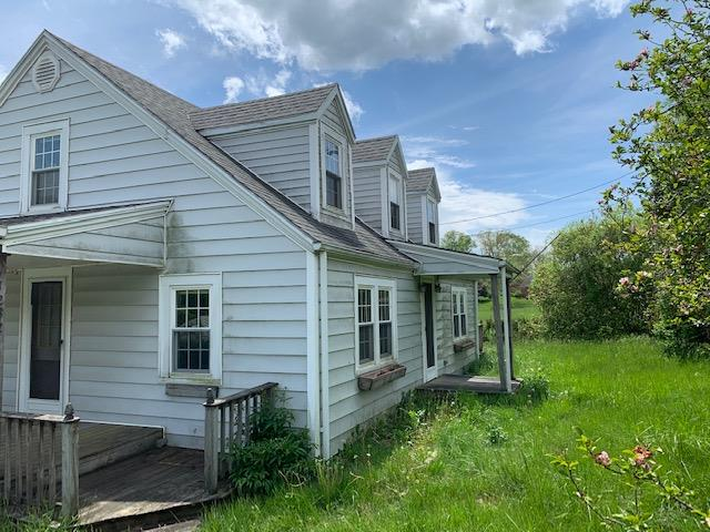 3 BEDROOM, 1 BATH HOME WITH 1536 SQ. FT., A FULL, UNFINSIHED BASEMENT, 224 SQ. FT. DECK, AND AN OUTBUILDING