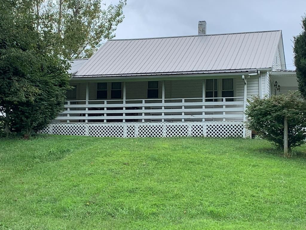 CHARMING HOME SITUATED ON AN ACRE +/- LOT. HOME FEATURES AN UPDATED KITCHEN, SPACIOUS LIVING ROOM, DINING AREA & LOTS OF ATTIC STORAGE.BASEMENT IS UNFINISHED EXCEPT FOR AN UPDATED BATHROOM. BONUS ROOM COULD BE USED AS A DEN, HOME OFFICE OR 3RD BEDROOM. REALLY NICE LARGE LOT.