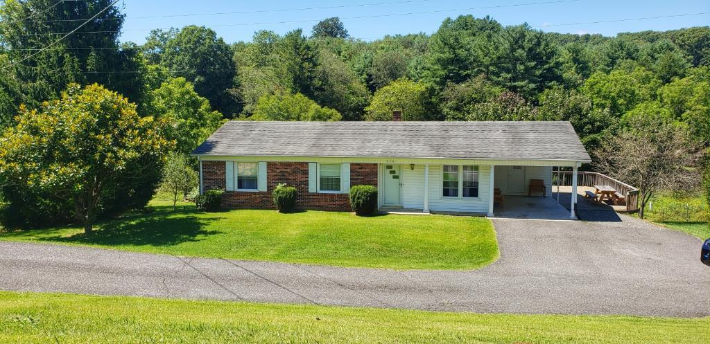Nice 3 bedroom, 1 1/2 bath home in desirable neighborhood in Galax. This home features hardwood floors, a full unfinished basement, a small cellar under the carport and a utility room off the carport.