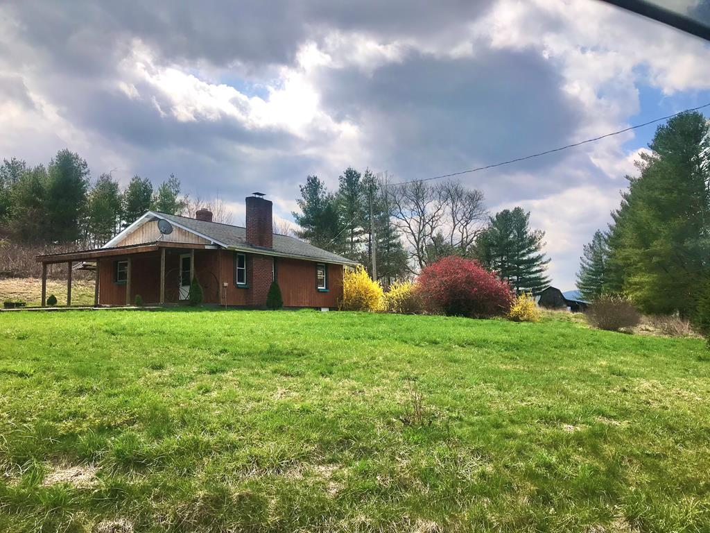 Less than 3 min. drive to National Forest, Hussy Mountain Horse Camp, and Iron Mountain Horse Trail! 3BD/1BA home sitting on 0.5 ac, a 1 acre pasture. This pioneer style home offers a large 25.5' x 10' concrete porch great for entertaining or just sitting enjoying the mountain view. Inside you will find an open concept kitchen and living area with original hardwood flooring, hickory cabinetry, and newer countertops. Living room offers wood burning fireplace, oil monitor, and more. On the side of the kitchen, there is a large sunroom and large laundry room, and pantry closet. Down the hallway from the living room are the 3 bedrooms and full farmhouse style bath with double sinks, and double toilets. Full basement with wood stove. Barn with 1 acre pasture at the rear of the home.