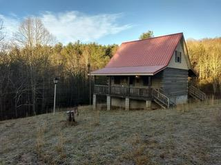 Custom built log cabin on 10 acres, private with a pond.