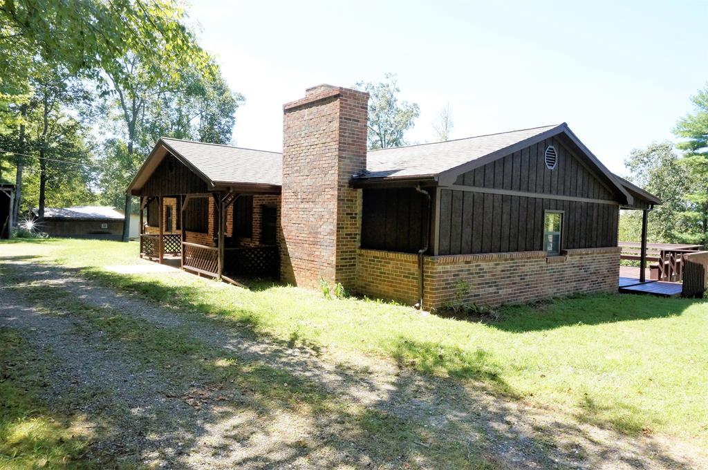 Very secluded! This three bedroom brick and wood sided ranch is nestled back on private 2 acre wooded lot. Move in ready  with new roof, new carpet and new paint. Home offers open living-room, kitchen and dining room with beautiful  wood-burning stone fire place. Covered porches and large open deck to enjoy the outdoors as well as a 20x30 Storage shed. Great mountain retreat or one level full time residence! Close and convenient to the Blue Ridge Parkway.