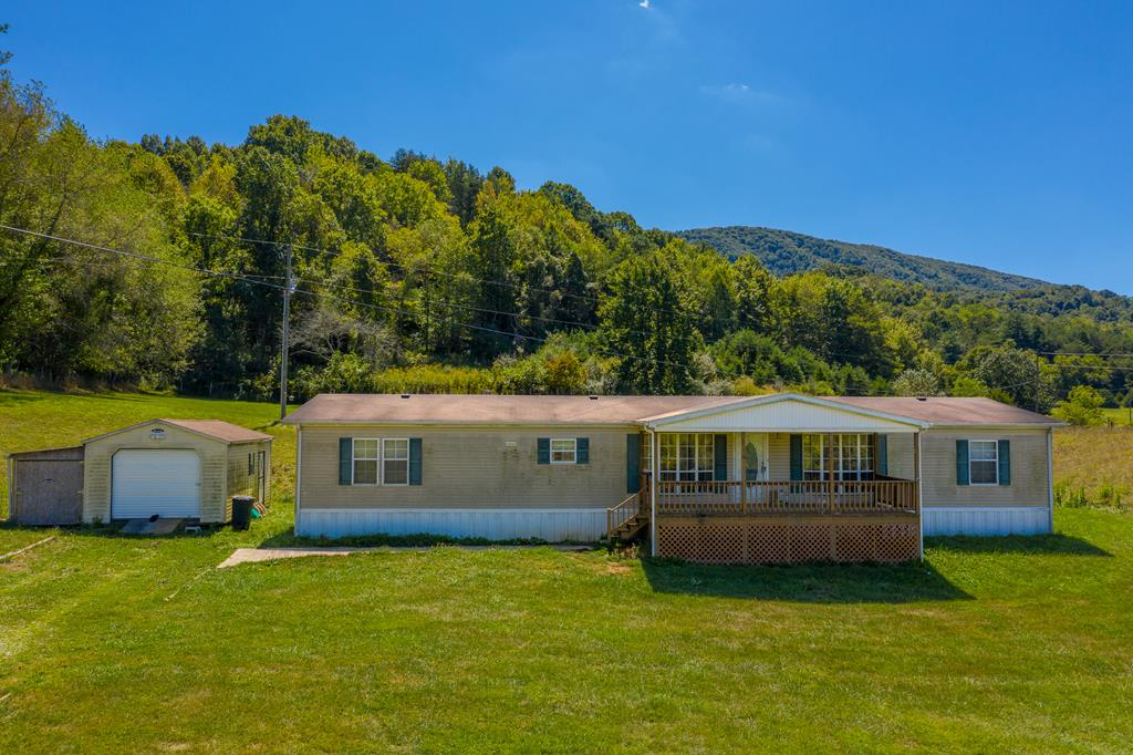 4 BR 2 BA Doublewide on +/-2.59 acres in Bland County, VA. Home built in 2002 and consists of 2,356 total finished sq. ft. Existing appliances include, range/oven, microwave, refrigerator, dishwasher, washer, and dryer. Large master suite and master bathroom with walk in closet. All other bedrooms located on opposite end of doublewide. Covered front porch and open deck at rear. Nice level to rolling yard which is easy to maintain. Fronts state maintained paved road and located out in the country away from the hustle. Outbuilding for storage and gravel driveway. Some regular routine maintenance needed, but with just a little TLC, this home has potential to be very nice.