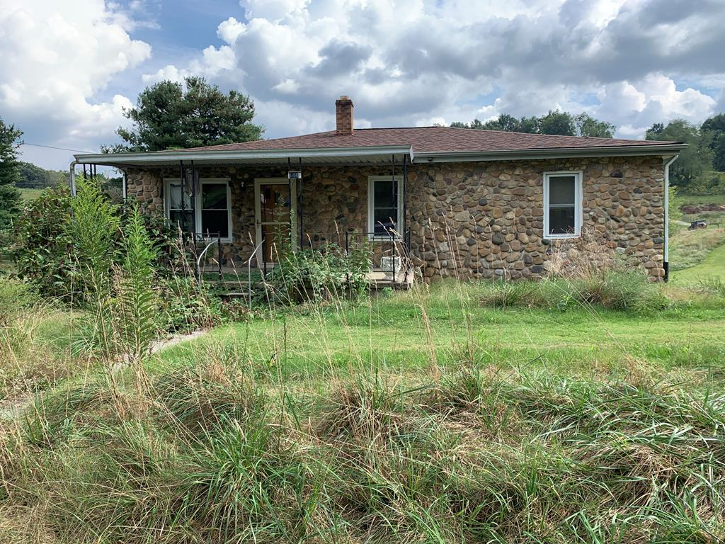 Nice 3 BR 2 BA fixer upper in a great location. Country living, yet minutes to town. This home already has a newer shingle roof and insulated windows, as well as a heat pump. Hardwood floors through most of the home. Full basement and nice large lot. There is a big metal building on the property as well as a detached one car garage. This is a medicaid sale. Home is being sold as-is and seller will make no repairs.