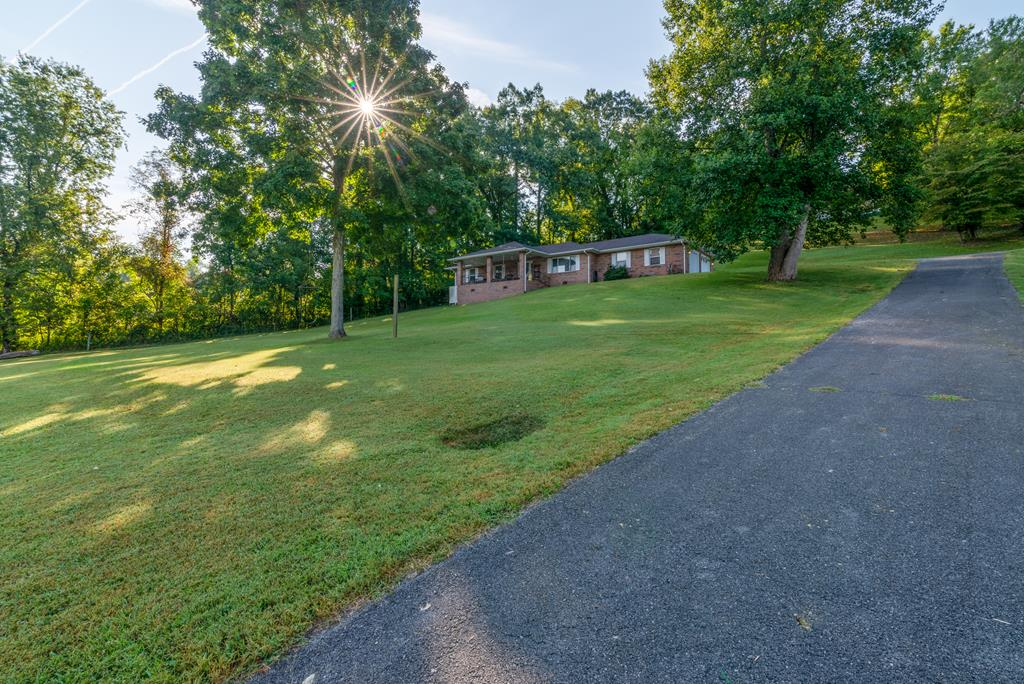 Looking for a home on the lake? This could be the one! This move-in ready brick ranch sits on 4.27 acres on the South Holston Lake! The property has direct access to the boat ramp and includes its own private floating dock. You can enjoy the beautiful views of the water and mountains from the private front yard or covered front porch. Features to the home include an open concept floor plan, newer carpet and an architectural shingle roof. In addition to being on the lake, this property has easy access to The Creeper Trail and AT. You can also kayak over to the Abingdon Winery or take your boat over to the local marina for lunch or dinner. The property is truly midway between lovely, refined, Abingdon and outdoor-oriented Damascus.