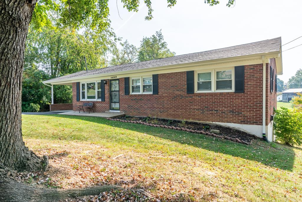 Come check out this all brick ranch home in the desirable Woodland Hills neighborhood.  This 3 bedroom, 2 bath home has an attached carport, an incredible finished basement area, and a nice, large yard.  This home also features hardwoods running throughout, neutral paint colors, a large deck (perfect for entertaining friends and guests!).  This is heated and cooled by a heat pump with a back up wood burning stove to cut down on utility bills.  This would make a great home for a first time buyer or a great investment property.