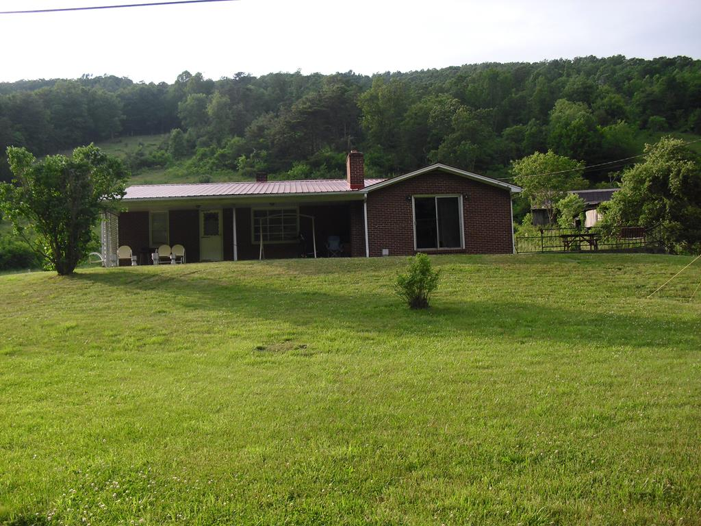 Nice 4 bedroom 2 bath brick home on over 4 acres of land!  This home and property is part of a 54 acre mini farm and additional acreage is available!  Located just minutes from the towns of Chilhowie and Marion, and Hungry Mother State Park!  Fishing, hunting, lots of outdoor activities close by!