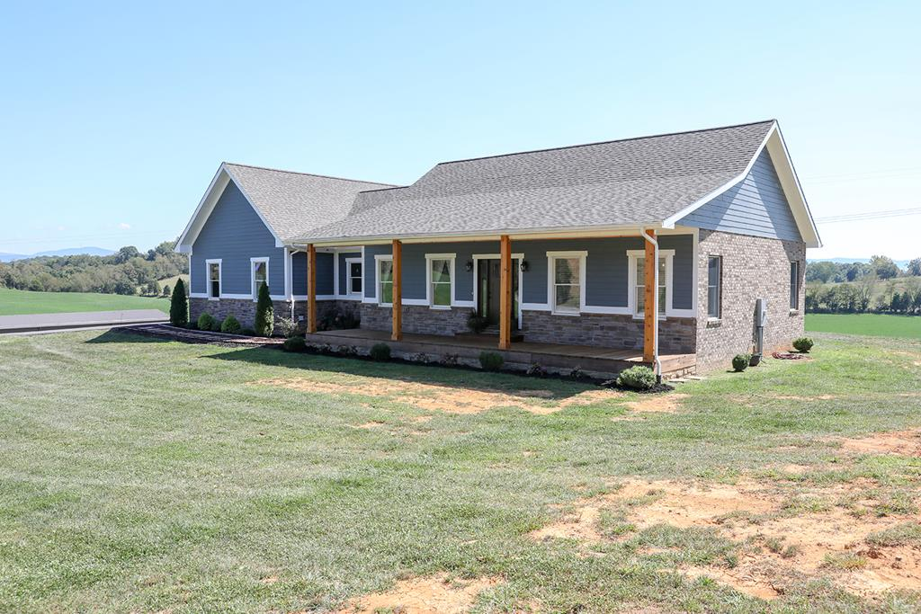 Custom built home perfectly placed on 134+- acres & only 5 minutes from Interstate 81 at Emory and Henry College.  Built in 2016, the 3BD/2.5BA home features a geo-thermal heat pump, open floor plan with vaulted ceilings, granite countertops and Andersen windows and patio doors, allowing natural light to fill each room.  A 500 gallon buried propane tank supplies gas to the stunning fireplace, cook-top, tank-less water heater and outdoor grill.  The attached garage was renovated to make a huge laundry/mudroom with tons of storage.  A newly added back deck covered with an A-frame vaulted roof supported by cedar-wrapped beams is the perfect place to soak in the surrounding beauty of the countryside or relax in the 6 person hot tub.  Plenty of extra space is in the partially finished, wired & plumbed basement with a walk-out entrance.  There are 67+- rolling acres with a 50x200 metal shop/shed/barn built in 2018.  See Addendum.