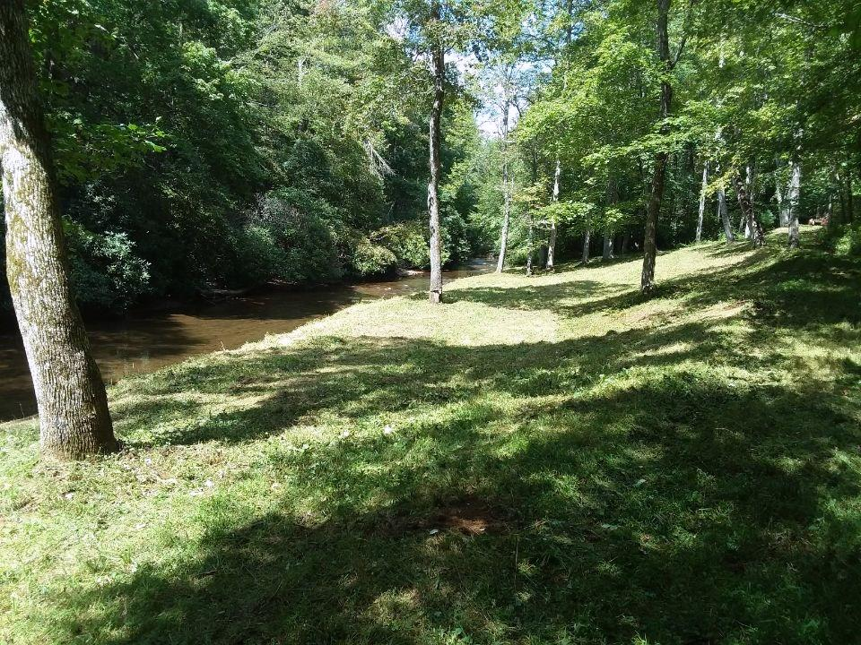 Gorgeous property  at an elevation of 2900' with 500+ feet on the Dan River, a native trout stream. Property consists of 50.38 acres in three parcels. Parcel one is 40.31 acres with frontage on the Dan River. Parcel two and three is 10.07 acres located in River Ridge Estates, a beautiful small development of homes with covenants to protect your investment. An acre on the river with picnic shelter provides members with a nice place for a picnic or family get together. There is a single wide mobile home located on the 40 acres (currently rented) with a well and septic system so if you want a place to stay before building your dream home it is already in place. Owner will consider dividing, 40 acres/ 10 acres. There is a small cemetery on the 40 acres in the far corner (see survey) . Propane is available for mobile home.