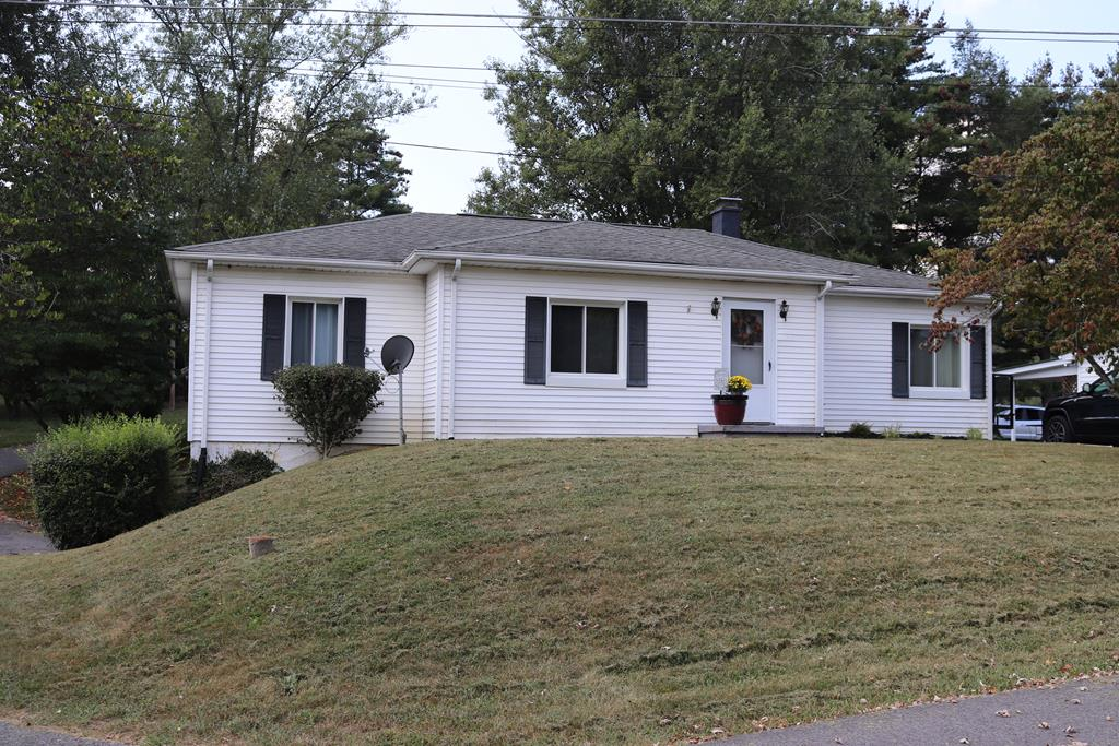 Check out this 1 level home in town limits. Cottage style ranch with original hardwood floors an arched passage ways. Cherry wood counter tops in the kitchen. Newer insulated windows.  Spacious rooms through out.  Room in the basement could be used for den or 4th bedroom. Central air. Paved circular driveway. Level lot. Nice quiet dead end street. Must see. Priced to sell.
