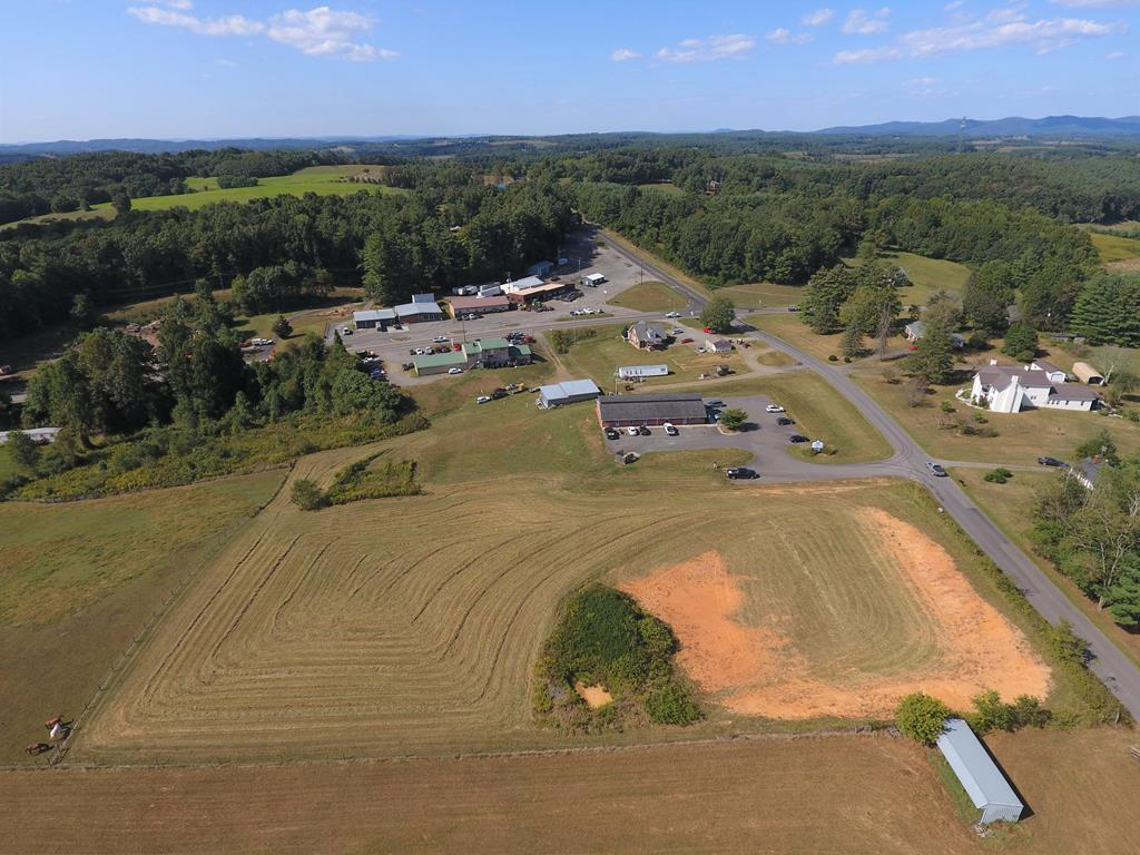 This nice 2.25 acre tract is located close to the busy intersection of Highway 221 and Route 100 and features paved road frontage, gently rolling topography, and public utilities are available! A quick trip down Hardscuffle Road will lead you to the new Highway 58 bypass as well as a direct route to Interstate 81 via Route 100! This would be a great place for your general commercial endeavor such as office space, clinics, storage buildings, and more! Don't miss this great opportunity!