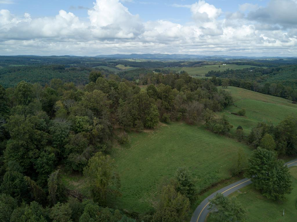 43 acres just half a mile outside of Hillsville VA town limits.  Amazing views of the mountains up top, would be a perfect place to build a house.  Great location less than 5 miles from I-77, this property has frontage on two state maintained roads.  With a spring, some woods, fencing, and pasture this would work great for cattle.  Priced below assessed value, come take a look at this property before it gets gone!