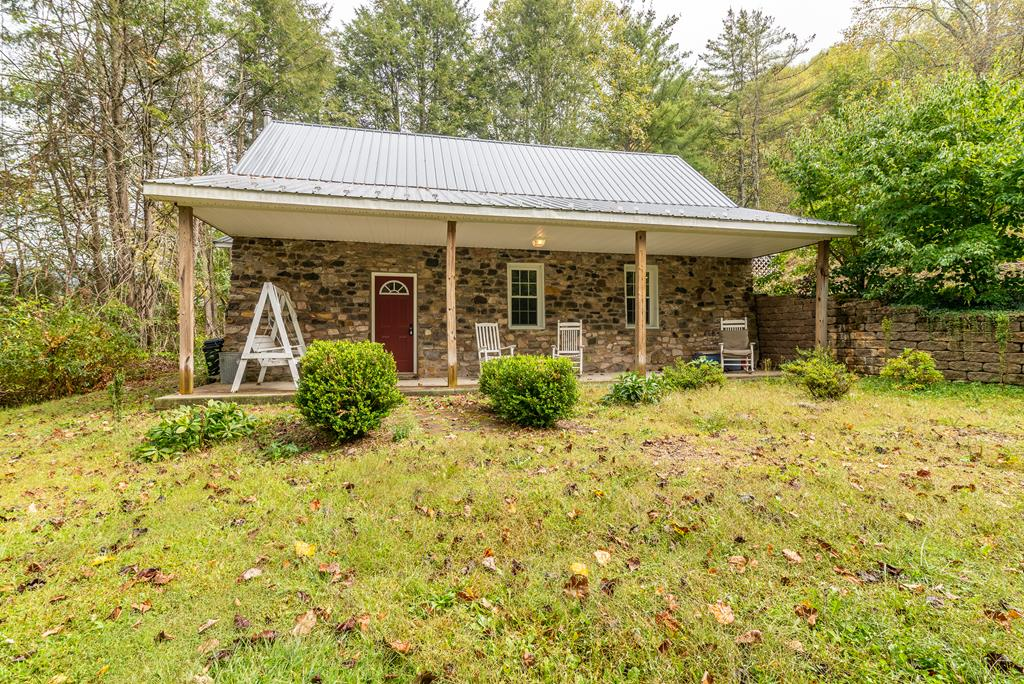Looking for a mountain retreat full of character and charm? If so, this could be the one!  The original structure was once an old country church built in 1920. You can only imagine the amount of history this property has had over the last 100 years!  The structure has seen been meticulously renovated and updated into a cozy cottage with modern updates and amenities. Features include an open concept living area and an updated kitchen with custom cabinets and granite countertop. Other features include a beautiful tile shower and hardwood floors throughout. The loft area has a second bedroom and a private back deck with outdoor access. The property is located on a very private wooded lot with beautiful mountainside views. It is just between Whitetop and the town of Damascus which includes regional attractions such as the Appalachian Trail, Virginian Creeper Trail and so much more! You won't won't to miss out on this rare find!