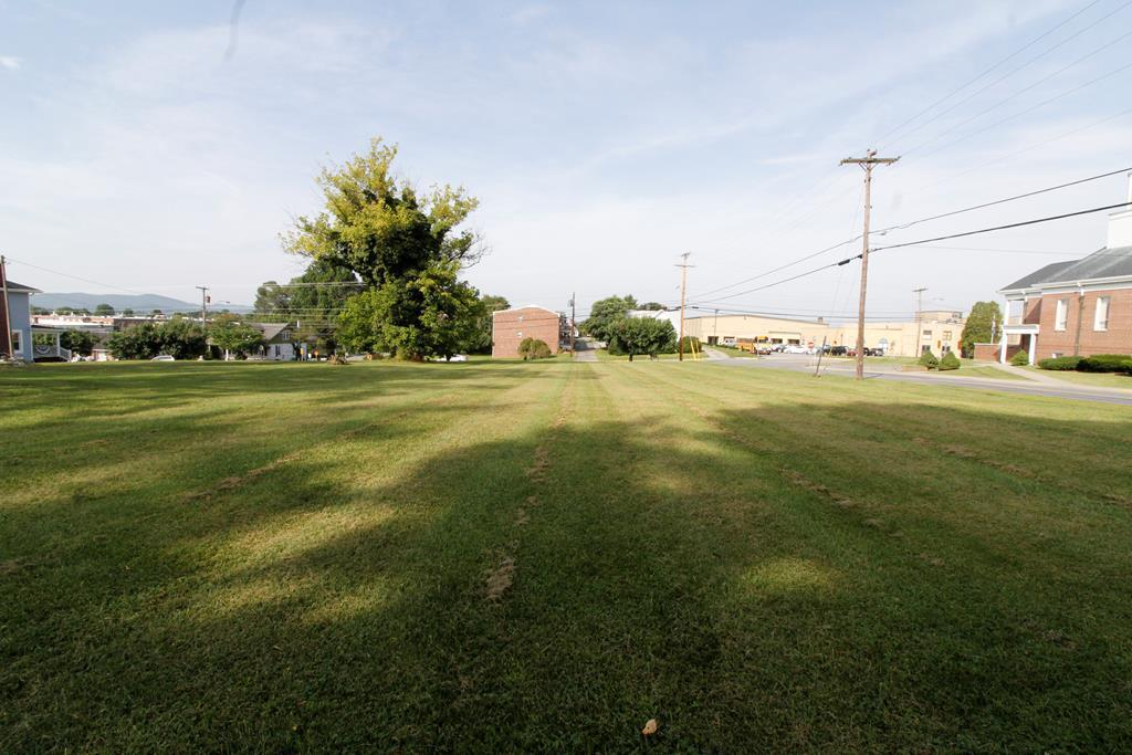 Commercial visibility, high traffic count, excellent site distance, fantastic ease of ingress and egress at this corner, growing location. This land is in a terrific location with high visibility, fronting on Main Street, with road frontage also on Edgewood Drive.  Public Water, and Sewer available, along with an entrance to the property off of Edgewood Drive. Seller states entrance off of Edgewood Drive has been VDOT approved for commercial use. Buyer and Buyers agent to verify this information.  If you have been waiting for that perfect location for your business build, than this could possibly be it.  Perfect for a variety of professional business's, restaurants, etc.  You are only limited to your imagination on this already cleared lot.  There are 2 storage buildings on the lot that do not convey with the sale.  Land is surveyed and completely level. Land is ready for your business and in the dynamic section of Downtown Hillsville that is the center of ongoing local events.