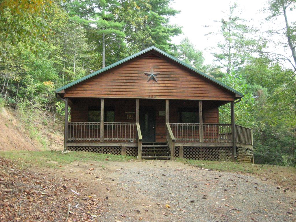 """COZY CABIN IN A WOODED SETTING ON OVER FIVE ACRES IN A GATED COMMUNITY WITH NO HOA, JUST A ROAD MAINTENANCE AGREEMENT WITH A $300 ANNUAL FEE.  THIS PROPERTY IS A DOUBLE LOT WITH FRONTAGE ON A WIDE PORTION OF CROOKED CREEK WHICH IS SUITABLE NOT JUST FOR FISHING, BUT FOR TUBING AND KAYAKS AS WELL.  THE QUALITY BUILT CABIN IS ALL ON ONE LEVEL AND HAS TWO BEDROOMS AND ONE AND A HALF BATHS, A LARGE GREAT ROOM AREA AND A SEPARATE LAUNDRY ROOM.  3/4"""" HARDWOOD FLOORING THROUGHOUT EXCEPT FOR THE BATHS AND LAUNDRY WHICH ARE CERAMIC TILE.  THE FRONT ENTRY BEGINS WITH A LARGE COVERED PORCH AND THERE IS AN OPEN DECK TO THE REAR OF THE CABIN.  SOME FURNITURE AND ACCESSORIES ARE INCLUDED."""