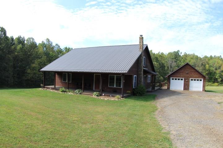 Beautiful well  built  country home  in excellent condition  (2,290 Sq Ft)  with  cedar siding located in Patrick County, Va (166 Misty Acres Lane, Meadows of Dan, Va 24120).  Built in 2008 on 4.12 acres partially wooded, just off the Blue Ridge Parkway near Mabry Mill. This Custom built home has a  gorgeous kitchen with maple cabinets and a large pantry, living room with Vermont Castings Dutch West wood stove,  1  large bedroom, full bath, office/computer room and very large laundry/utility room on the first story. Upstairs has one bedroom, full bathroom and very large bonus room.  Double pane - double hung windows.  Amenities include: Generac whole house generator, central heat and air conditioning, gas furnace and wood stove. Gas cook stove and gas dryer. There is a 2 car garage with custom built workshop the entire width of the garage.  Large front porch with swing and large back porch with entrance into laundry utility room.