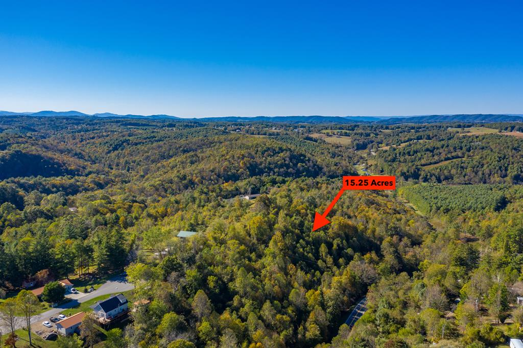 15+ acres in Hillsville Town Limits fronting N Main Street & Crestview Drive. The property has long road frontage along Hwy 52 and one acre of this tract is zoned as commercial per Town of Hillsville. The best building site is at the end of the quiet cul-de-sac on Crestview where public water is available. Give us a call to check it out for yourself.