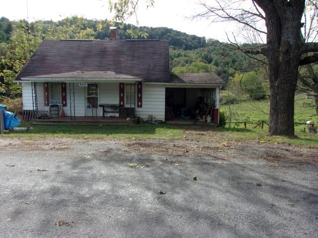 Home about 1 mile from the Town limits of Independence.  Well & septic.  Garden area.  Very good location. Home in poor condition.