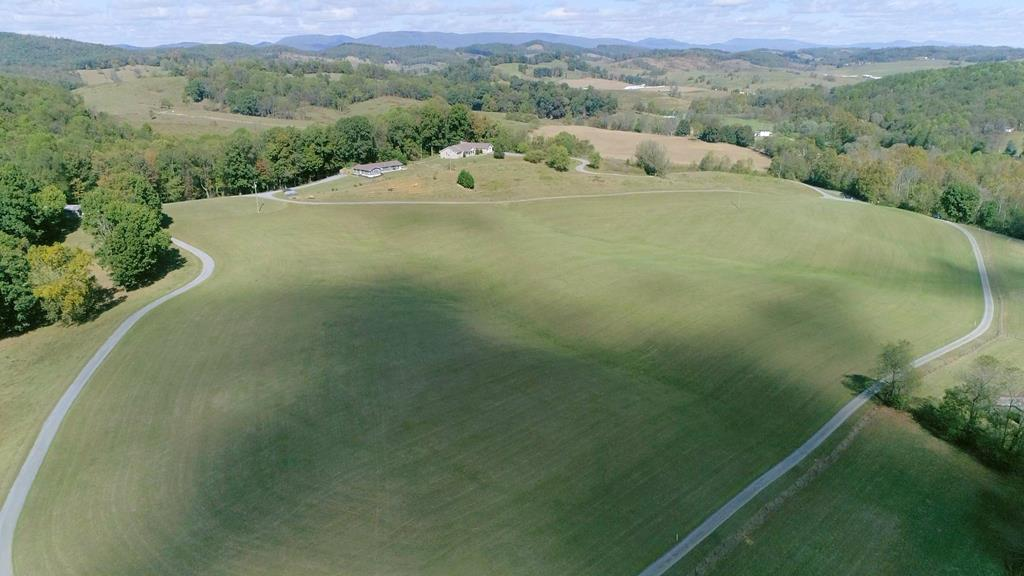 This large parcel of land has so much potential!  There is a home site surveyed, which has been perc test approved.  Additionally, there are gorgeous mountain views, a usable barn, some fencing, and a pond!  Whether you want to build your dream home, have a mini-farm or both, this property works!!  Come see it today!