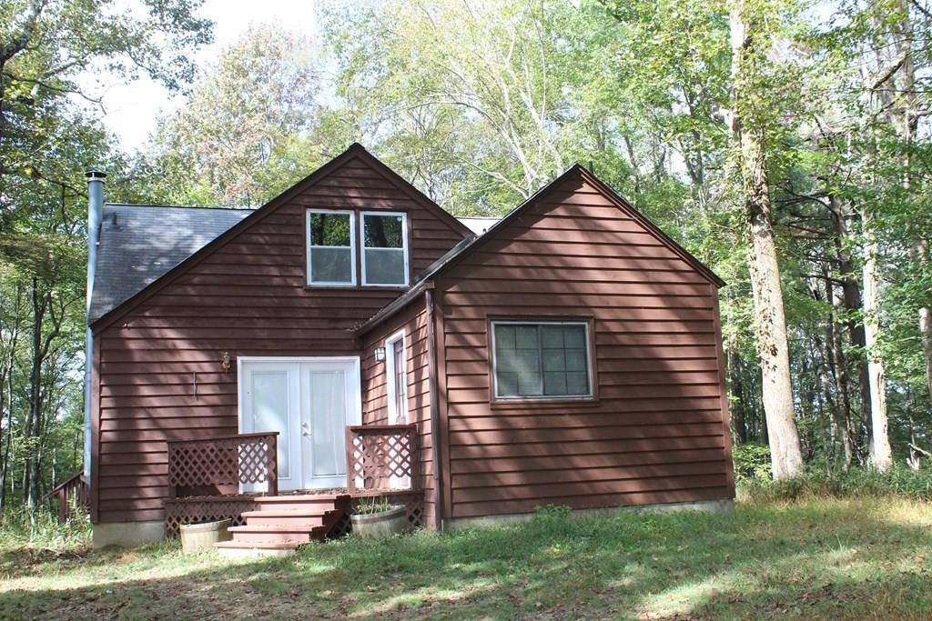 Tucked away on 5 acres of totally wooded land, this property offers pure serenity for all who wish to get away from all the cares of daily living.  Whether you're looking for a vacation home or a permanent home, you'll find this property located in the mountains of Meadows of Dan, VA.  A new gas furnace was installed in 2017, as well as new windows in 2010.  The house was painted in 2016.  A new well was dug in 2017.  The bedroom upstairs has double windows to let lots of light in, as well as give you the feeling of being in a tree house.  Nice Heart Pine floors throughout, with tile floors in the kitchen.  Open floor plan on the main level.