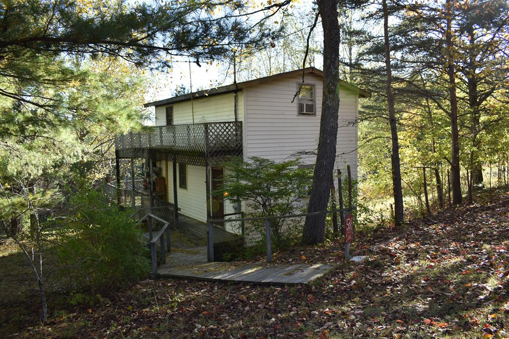Right off the Blue Ridge Parkway you have a 768 sq ft cabin, on the main level is your living room, kitchen, dining and full bathroom. Upstairs you have a large bedroom with its own deck. There are two large decks on the home.