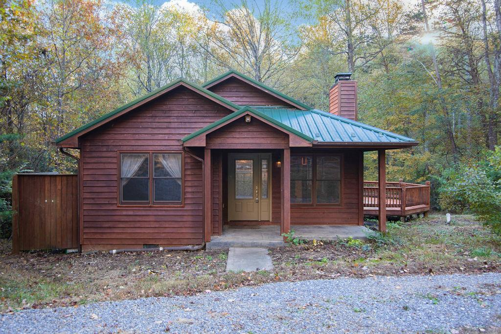 This adorable 2 bedroom, 2 bath cabin can be found just off the Blue Ridge Parkway, nestled in the woods of Cascade Mountain Resort. Home has an open floor plan that offers a wood burning fireplace. Kitchen has a large island with extra storage space, two bedrooms and two baths all on one level. This cabin would be perfect for a second home or full time living. It is located in Cascade Community that offers an outdoor pool, tennis courts, playground, hiking, clubhouse and community pond.