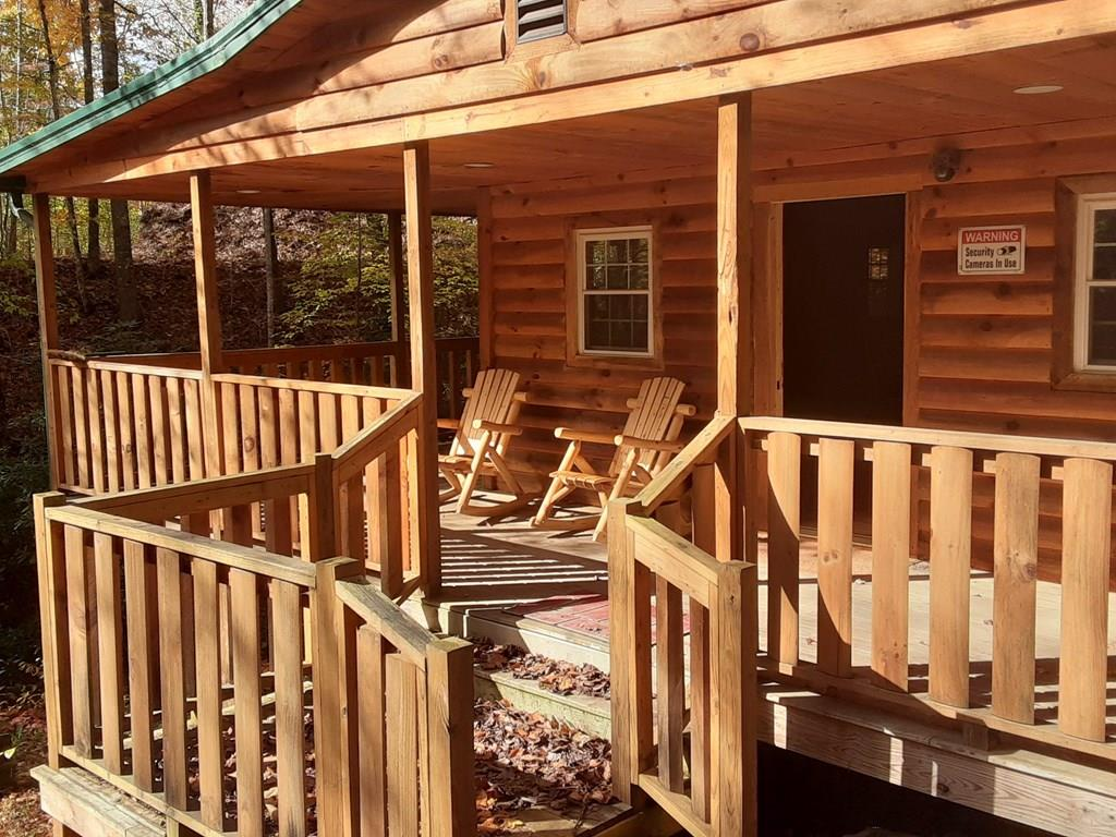 ATTENTION HUNTERS, OUTDOOR ENTHUSIAST, AND VACATIONERS!!!! Whether you just want to get away from the hustle and bustle, and ringing telephones, or if hunting and fishing is what you prefer, take a look at this cabin. It is a two-bedroom, half-bath get-a-way, situated on .66 acres. Relax on this L-shaped porch, take a walk down to the trout stream for fishing, or hike through the woods, property borders Jefferson National Forest. The cabin has been remodeled in 2016, with all new walls. roof and hard wood floors, designed to operate off of battery power and generator, stove and heater are propane, Cabin has satellite dish attached, service reception needs to be verified by buyer or buyer's agent. Cabin sits off of national forest road for easy access. See what this property has to offer today!!!