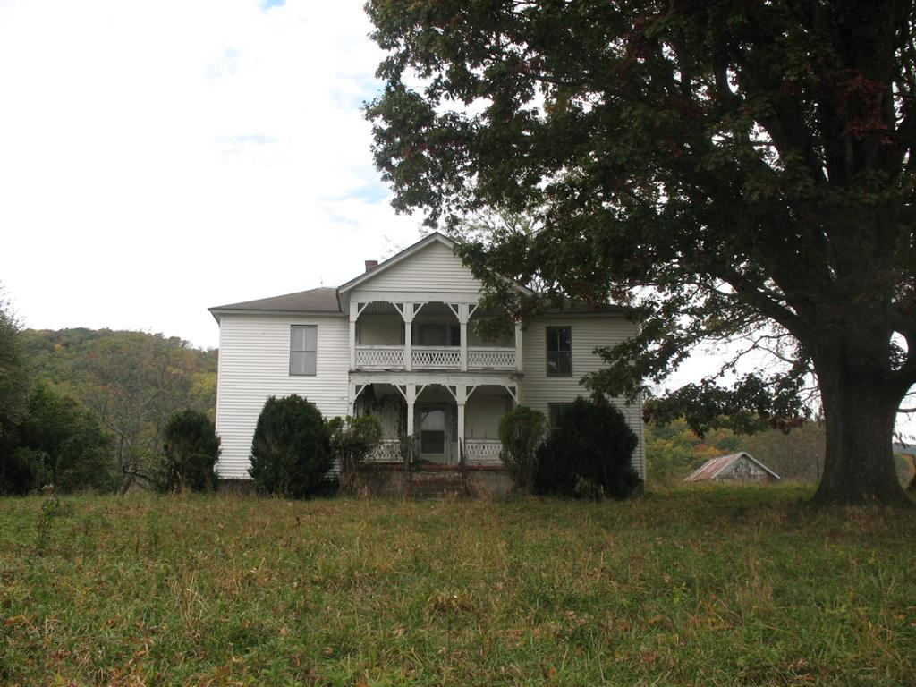Located in beautiful Grayson County is this 165.4 acres working farm. Pumpkins and corn corps are being planted. Property is fenced for cattle. Property has two springs and a small creek for the animals. Two barns on the property and other outbuildings. Land is gently sloping. The old home place was built in 1900 and will need updating. Property  has plenty of wildlife, deer, bear and turkey. Would make a great Christmas tree farm or development.