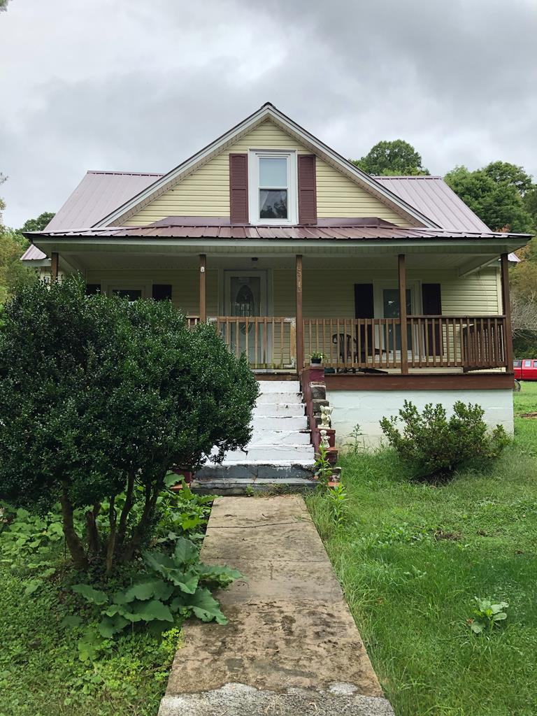 Seeking isolation for your family but still near to town amenities? Here it is in beautiful Konnarock, 20 minutes from Damascus! 37 acres with a fixer-upper home (currently not livable) and additional mobile home site.Breathtaking views of Whitetop Mountain and more. Backs up to Jefferson National Forest; back property line runs along the ridge of Straight Mountain.Small lively creek running through the property.Laurel Creek is across the road from the house. Multiple building sites with existing views and multiple others with potential views with clearing. Several already cleared level areas throughout the property are suitable for pasture.One pasture further up the property is well off the road and would be a great RV spot. Conveniently located for full-time or vacation living. Damascus, Abingdon, the Virginia Creeper Trail, Grayson Highlands State Park, and Whitetop Mountain are all only a short drive away. Owner/Agent.