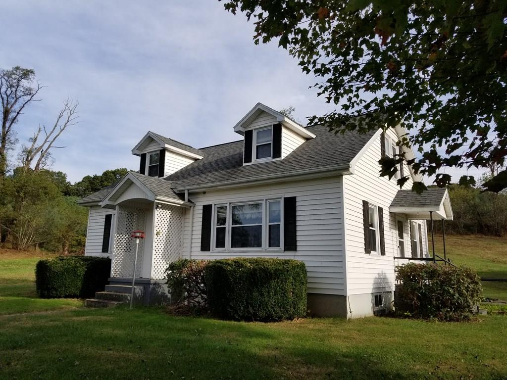 Charming 1.5 story home conveniently located between Independence and Galax. Not far from the New River and a public boat landing for kayaking or tubing. There's a detached two car garage and paved driveway. Nice level garden area and mature trees on 2.86 acres.   Great climbing trees in the rolling front yard for the kids to play.   This home has great curb appeal as you approach this country setting.   It has a feeling of home as you drive up.   Plenty of bedrooms for a growing family or it's possible to close off the upstairs and only use the main floor.   A great addition for our fall market!