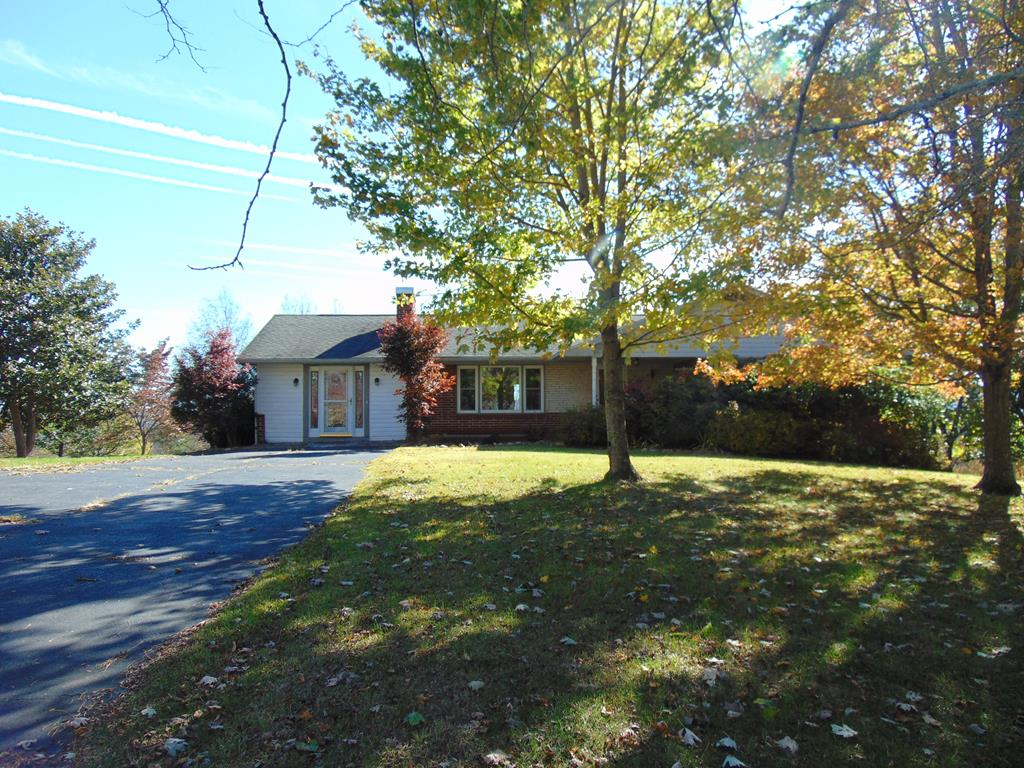 Views of the mountain ridge & 1 level living Welcome you Home in this low maintenance brick ranch that is ready to move into!  Paved drive off of a paved state road just minutes from the New River & the town of Independence, about 10 minutes to Galax.  Tile, hardwood & LVT flooring throughout, laundry and 2 bedrooms on the main floor.  Lovely concrete patio below, 3 decks and a sun room above on the back side of this house to take advantage of the great mountain views!  The kitchen has updated counter tops & appliances, more features you want include a generator + a 500 gallon propane tank to supply it, HVAC, replacement windows, updated baths, gleaming hardwood floors, many fruit trees & an amazing variety of deciduous trees in the immediate yard, the extended area of the property is a mix of open field & trees.  Views, close to town, paved road & drive & move in ready.  This is the one you don't want to miss!  Call today to see this view-ti-ful home, it's a really cool place to be!