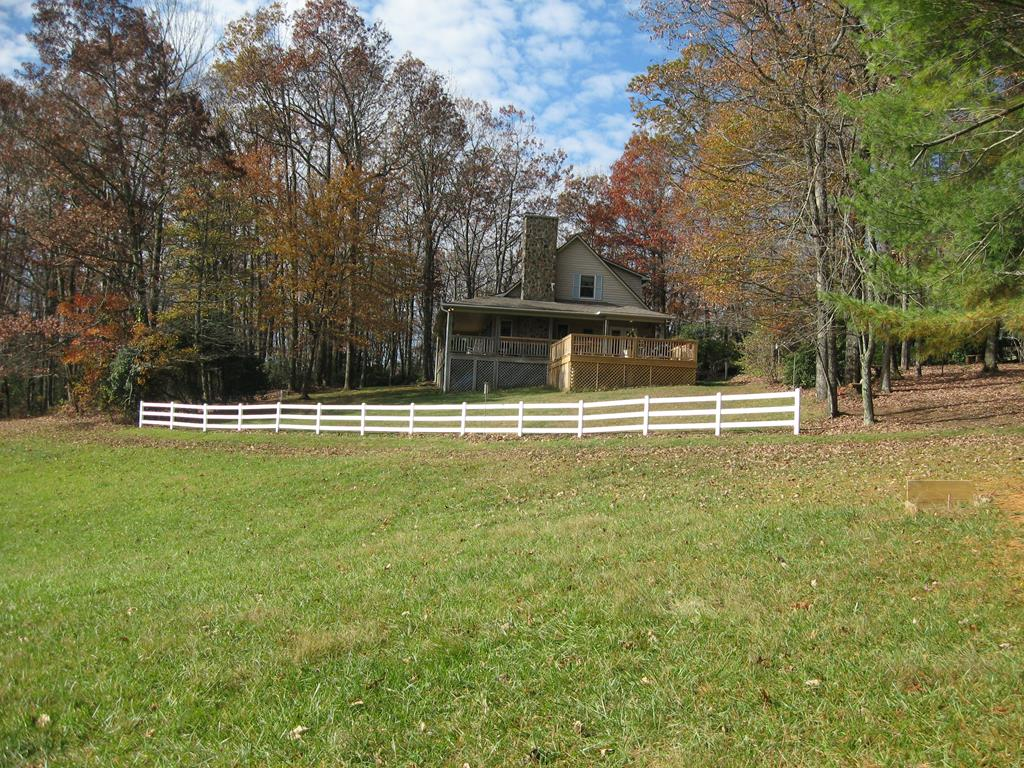 BEAUTIFUL MINI-FARM IN A GREAT LOCATION WITH A WELL CARED FOR HOME AND A SMALL BARN. IDEAL PROPERTY FOR HORSES WITH PLENTY OF PASTURE AND WATER. NEW ITEMS: 20' x 20' OPEN DECK, OVEN/RANGE, AND DRYER. INCLUDED ITEMS ARE: ONE YEAR OLD CUB CADET ZERO TURN MOWER WITH UTILITY CART, EZ-GO GOLF CART, GAS GRILL, ALL PORCH FURNITURE EXCEPT ALUMINUM TABLE AND CHAIRS SET AND TWO ROCKING CHAIRS. NO HOUSE INTERIOR FURNITURE IS INCLUDED.