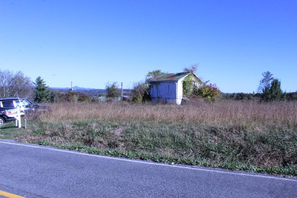 This property is ready for you to start building. The owner has already paid and still pays for public water access. Just hook it up. 2.3+ acres of relatively level land. There is a  6x10 well house with a hand dug well for washing the car, watering the animals or any number of other uses. It is cinderblock and has a concrete floor.There is also a 2 story 8 x 12 outbuilding previously believed to be used as a root cellar (has a concrete floor) on the bottom and for storage on top..  This property is a prime spot to put your Dream Home . Sit on the porch and take in the  Beautiful view of Buffalo Mountain. Pick your own pears and cherries from the  Pear and Cherry Trees  Just enough land to have a few chickens or maybe a cow. Plenty of room for the kiddies and pets to run and play. Convenient to town and all the amenities that are so important, grocery store, drug store, banks, doctors, restaurants, and many more., Some fencing in place if you are interested in a mini farm.