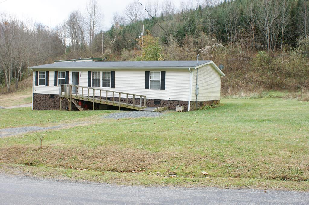 This property is nestled in the heart of the highland country of Grayson County.  Imagine the musical sounds of the bold mountain stream that runs on the property.  Just beautiful!  The home is extremely well kept.  Featuring a large eat in kitchen with bar and a large living room.  This home is made for family gatherings.  Three bedrooms offer plenty of room for overnight visitors.  Just a short distance from Grayson Highlands State Park.  Bring your horses!   Call us to schedule an appointment to go take a look.