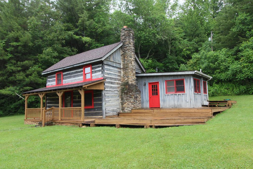 "Completely restored rustic 1870 Log Cabin on 34.67 secluded acres w/beautiful pond. Trails all over the property, trophy wildlife roam freely. Welcome home to this cozy cabin from days gone by with all the charm and character buyers seek. The seclusion is magnificent. 25'x50' Covered Lean To Horse Barn, lush level pasture and meadow, large private pond, mix of hardwoods & very serene and peaceful. Private well, private septic, separate garden shed/chicken coop area. Floor to ceiling stone wood burning fireplace hearth, open floor plan, large kitchen, separate dining room, master on main, second bedroom and nice loft area which is home to another bed. The covered rocking chair porch and large open deck lend itself to additional outdoor living area to enjoy this ""Ponderosa"" property. Take in the beauty of Mother Nature in all 4 seasons. Perfect for VRBO, HomeAway rental property should buyers be seeking such. This log cabin home FEELS so good from the second you see it to walking inside."