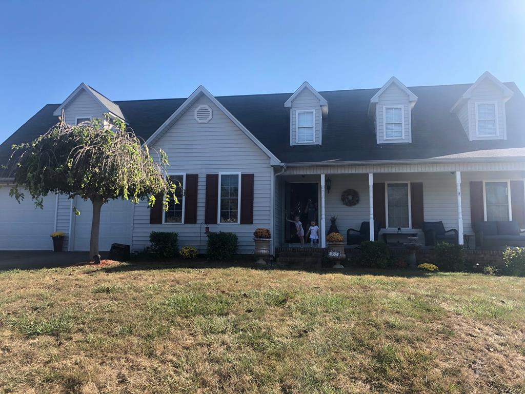 This beautiful 4 bedroom, 3 bath Cape Cod style home is in a great location that is convenient to shopping and schools. It features a beautiful kitchen and dining area with hardwood throughout. The view is gorgeous from the front and back porch. Home also has large two car garage.