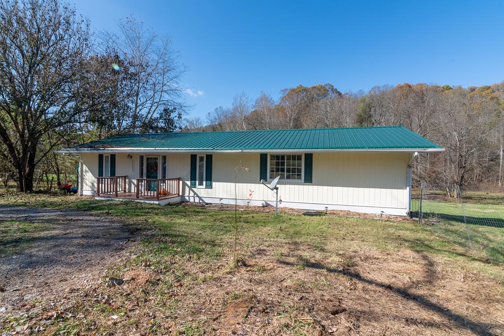 Located within 5 min. of Abingdon, close to all of your town amenities, but country living on 1.94 acres with a creek, privacy and one level living.  This home has lots to offer:  new metal roof in 2015, new heat pump in 2016, insulated windows, freshly painted front porch and back deck, large deck for entertaining as well as for personally relaxing while watching the babbling creek flow by, large yard with fencing for pets and children plus plenty of space for a garden.  The backyard would also accommodate any outdoor recreational activities and a nice fire pit.  You will also find a circle driveway making coming & going easy, a great workshop with electric to fit any hobby needs or maybe just use for extra storage space.  The building was extended in 2018, doubling its size to offer more space for whatever you may need.  The original home was built in 1989 and then was remodeled and an addition added in 1995.  The home now has a great, open modern day feel upon entering.