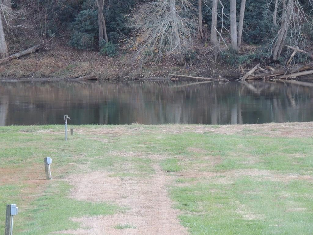 THIS RECREATION RIVER LOT IS IN A GREAT LOCATION BETWEEN INDEPENDENCE AND GALAX. THERE IS A SEPTIC IN PLACE AND THE OWNER IS CURRENTLY INSTALLING A PRIVATE WELL AS TO DISCONNECT FROM A WELL THAT IS CURRENTLY SHARED.  ELECTRIC IS ON THE PROPERTY AND THE HOOKUPS ARE IN PLACE FOR YOUR CAMPER SO  BRING IT ON DOWN AND GET READY FOR SOME RELAXATION AND FUN!!! BRING THE KIDS OR GRANDKIDS OR SIMPLY JUST COME AND LISTEN TO THE RIPPLES OF THE WATER. LOCATED ON THE HISTORIC NEW RIVER!!!! ENJOY CAMPING, SWIMMING (WITH EASY ACCESS INTO THE RIVER,) FISHING, CANOEING, TUBING OR JUST SIT AND LISTEN TO THE QUIET AND READ A BOOK. THE PERFECT PLACE TO JUST TAKE A BREATH FOR A COUPLE OF DAYS AND GET AWAY FROM EVERYDAY LIFE.  THIS PROPERTY IS A LITTLE SLICE OF HEAVEN. CALL TODAY FOR ALL THE DETAILS AND TO MAKE AN APPOINTMENT TO TAKE A LOOK. PRICED TO SELL!!!!!