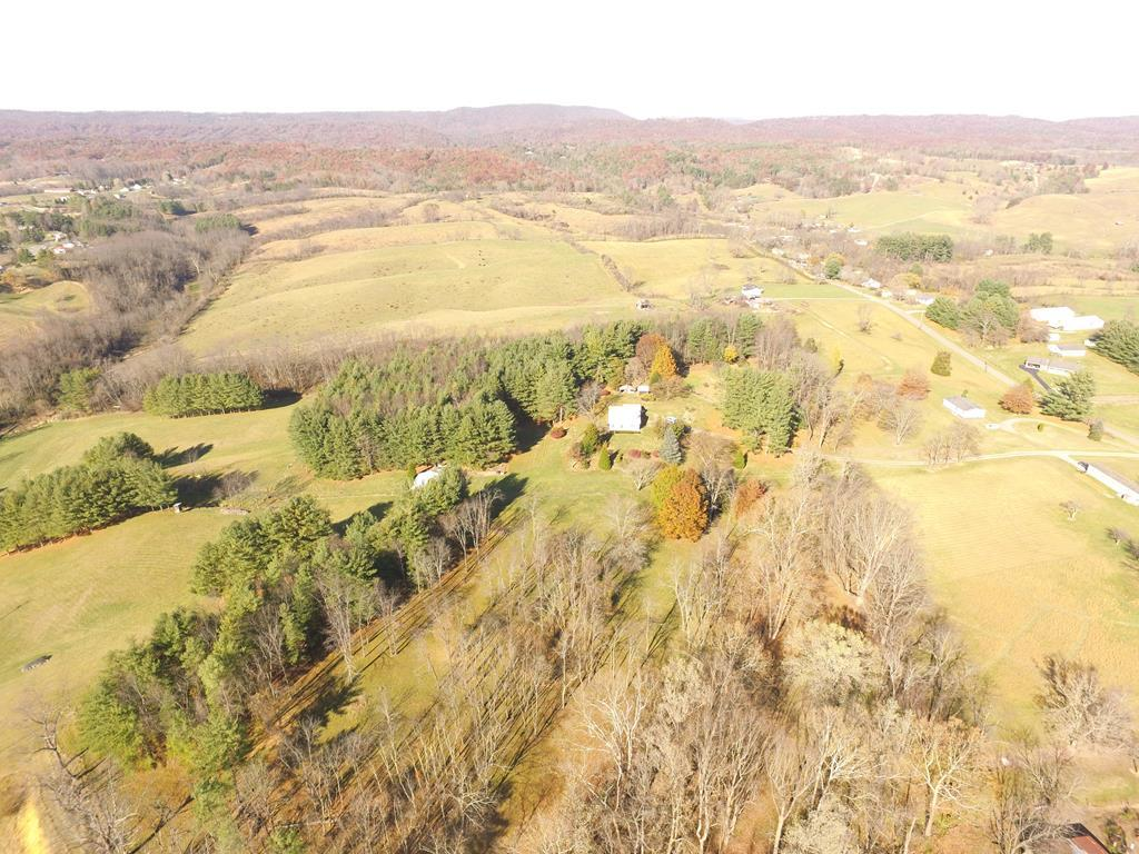 Beautiful private 16 acres with 4 BR, 1BA home with over 1900 square feet of living space.  This property has mature marketable white pine.  Space for horses and other live stock, large fenced garden area, beautiful views.