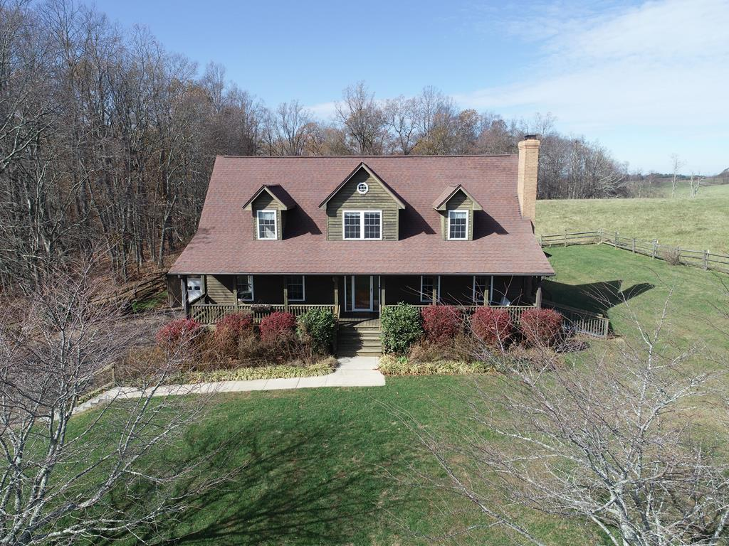 This beautiful 3+ bedroom home is nestled in the midst of 24.5 peaceful acres! This property features a pond, 1 car detached garage, 2 car bsmt garage, finished bsmt w/ full bath, bedroom & living area, master suite on main w/ walk-in closet & jetted tub, open kitchen/dining/living w/ hardwood floors, wood burning rock fireplace in the living rm, screened-in porch off the dining area, Approx. 11 acres of fenced pasture and 11 acres of timber, generator powered by propane & great views from every window!