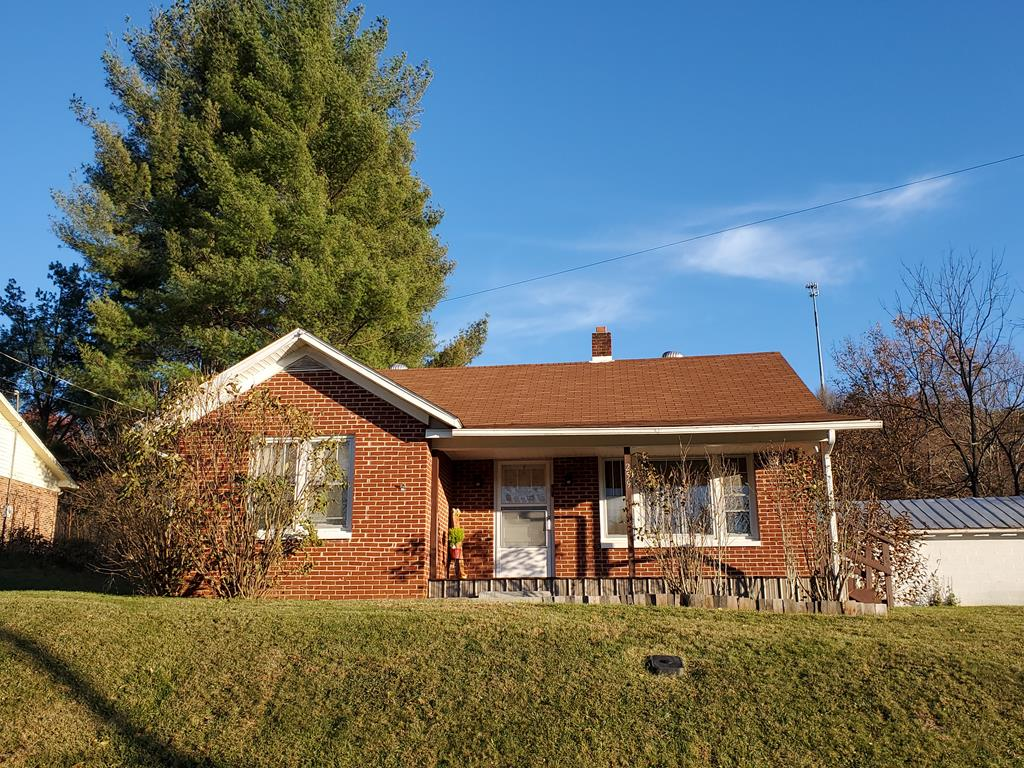 Country feel, yet only a couple minutes from town. All brick home in desirable location. When you walk in the doo you feel at home. Very cozy home. All rooms are nice size and features a mud room as well. There is also a storage shed and power for the shed.