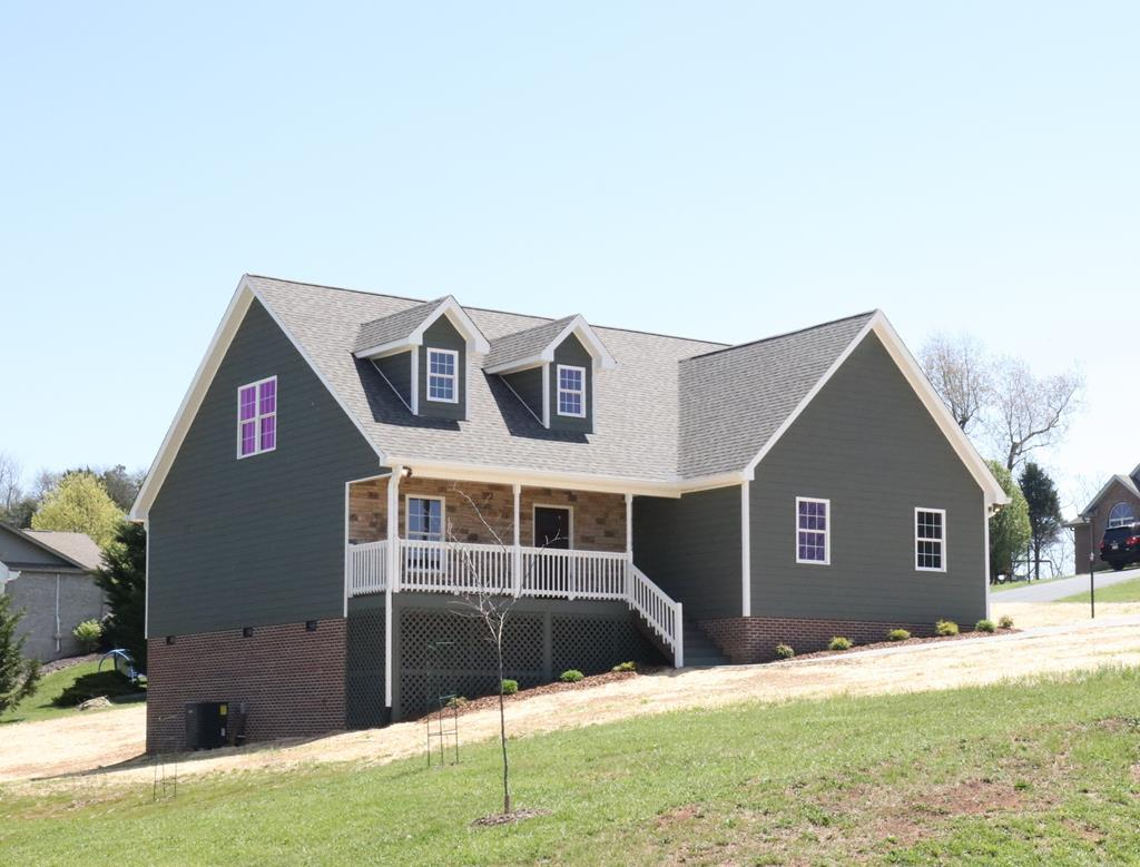 This Nearly New Construction is ready for it's First Owner! This 3 Bedroom, 2.5 Bath Traditional Plan is located on a corner lot in the New Section of Deer Run Estates. Kitchen has Homecrest Brand Cabinets with an Espresso Stain. Counter Tops are a Brown, Gold and Dark Granite. Stainless Samsung appliances complete this Kitchen. Master is on the 1st floor with a large Walk-in closet. 2nd closet in the master bath is suitable for extra hanging storage as well as linens. Family/Living room leads out to a screened deck. 2nd floor has 2 very large bedrooms and a shared bath with 2 sinks. Hardwood and Tile Floors throughout the first floor. Carpet in the two upstairs bedrooms. Home has been professionally landscaped. Exterior is Smartboad Siding. Located outside the City Limits, so only County taxes apply.