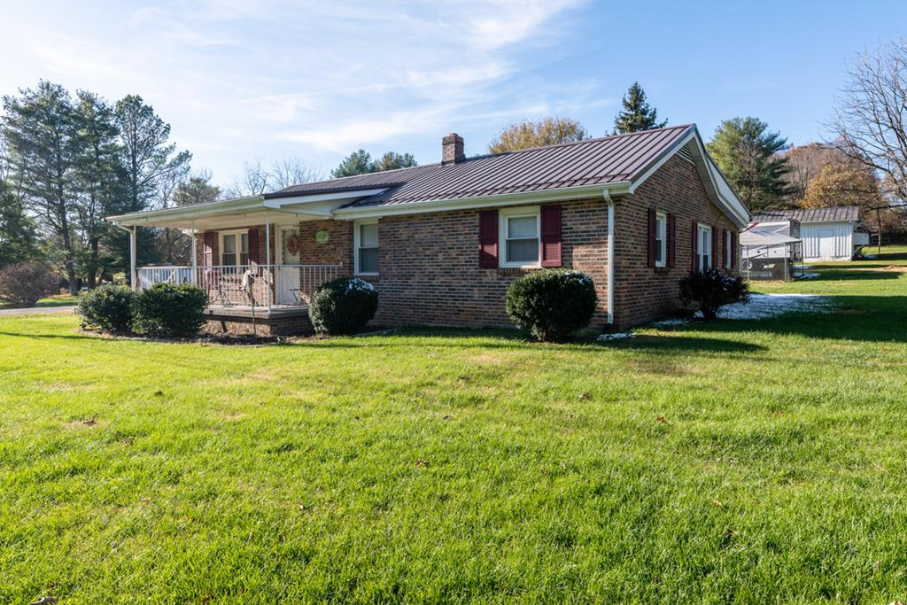 Brick home, well maintained with updates located half way between Abingdon and exit 7. Very convenient to Abingdon and all the amenities that exit 7 has to offer. This lovely all brick home has a metal roof (2006), replacement windows, heat pump (2011), newer kitchen S/S appliances, newer counter tops and backsplash, updated bath, fresh paint, wood floors throughout except for kitchen, bath, mudroom and sunroom as well as newer flooring in kitchen and new flooring in mudroom area. Old galvanized water lines and iron sewer line were replaced with NEW water lines and sewer line (see pic of basement).  Old buried oil tank was removed.  Large kitchen with lots of cabinets offering plenty of storage, plus a pantry located just off of the kitchen in the mud room which has access to a cute seasonal sunroom. Spacious dining room and an eat-in kitchen with an open floor plan to the living area.