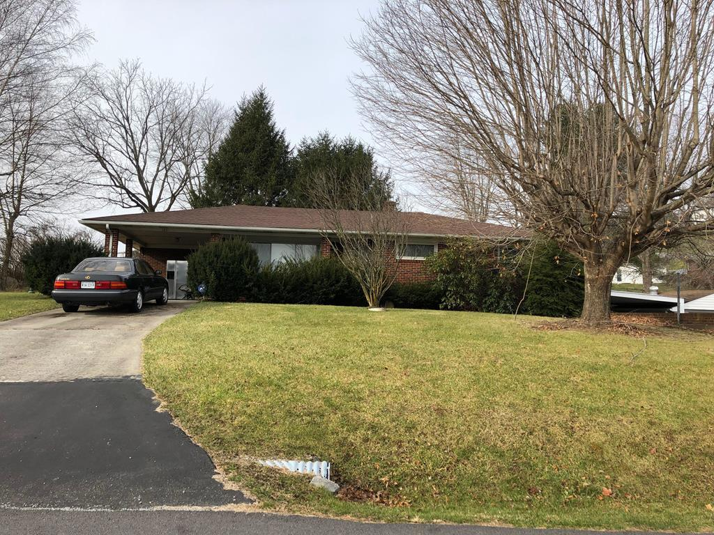 Brick ranch with full finished basement. Property that goes with the house stops at the end of the pavement to the right of the house. Owner decided to divide the acreage from the house to make it a deal for a purchaser.