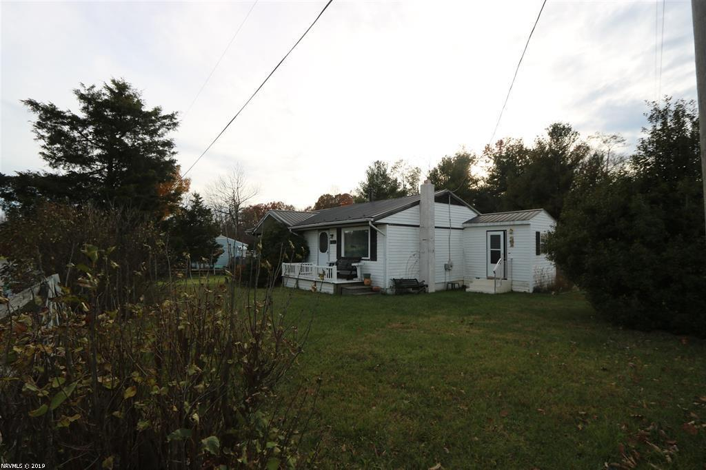 Affordable Ranch home in a beautiful part of Floyd County. Nice detached garage and shed all on .62 acres. Medicaid forced sale sono offers lower than asking price. Home needs some TLC. Great corner lot and home has new septic system. New metal roof.
