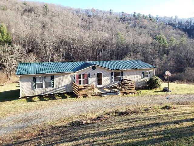 Nice and private 4 bedroom 2 bath home situated on 5 acres with a creek! Spacious home with new heat pump in 2019, metal roof, laminate and carpet flooring, kitchen appliances included! Acreage is perfect to have a few horses. Located within 1/2 mile of a stocked trout stream and Crooked Creek wildlife Management area!
