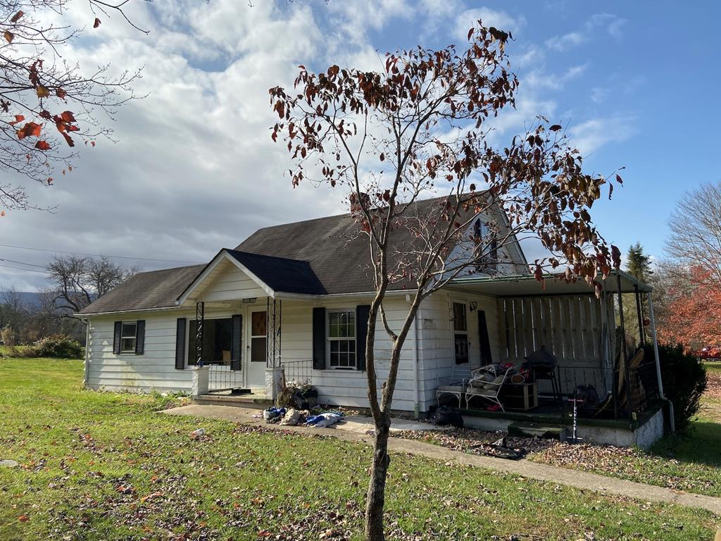 Attention Investors! This is a true fixer upper located a short distance from the town of Marion. Home is a 3 bed 1 bath with one bedroom on the main level and two bedrooms upstairs. There is a lot of potential here! Yard is mostly flat with several outbuildings. Priced to sell!