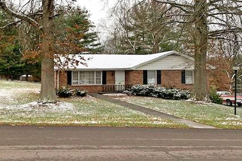 Brick home in Westwood Estates on nice level half acre lot, featuring large living room with adjoining dining area, open kitchen to den with nice cozy fire place, 3 bedrooms, and 2 baths.  Basement has one car garage. Large area for a family room with another fire place.  Laundry and lots of storage space,